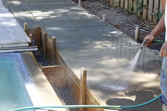 CONCRETE WALKWAY BEING SEALED